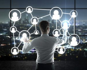 businessman pushing interface with social icons